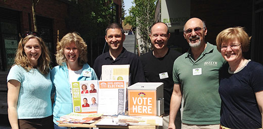 (l-r) Julie Tempest, nominating committee chair, board candidates Maggie Lucas, Jason Filippini, Michael Hutchings and Sandy Voit along with nominating committee member Janet Hietter campaigned at the Greenlake Village store on May 9.
