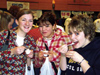 Group of people sampling new foods at Vegfest 2003.