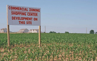 Commercial development sign in corn field.