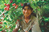 A Mexican coffee farmer in his element among the lush, shade-grown environs of a Fair Trade coffee cooperative.