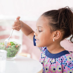 kid eating salad