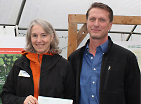 Andrea accepting check from Scott