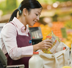 woman bagging groceries