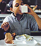Young boy drinking milk in school cafeteria