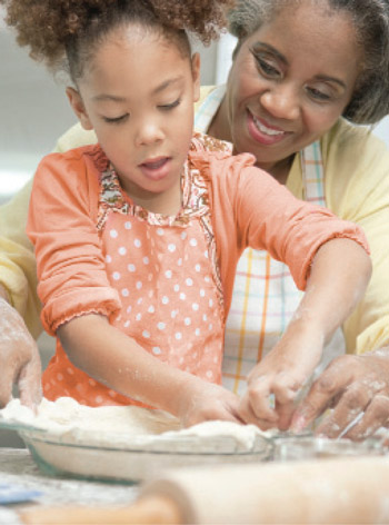 child with Mom baking