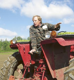 Full Circle Farm owner Andrew Stout on a tractor