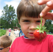 child w/strawberry