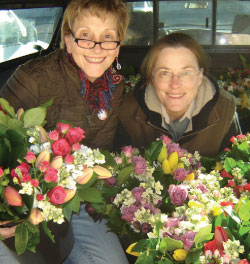 2 women holding flowers