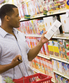 shopper reading labels