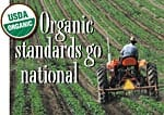 Picture of tractor in field with captain, 'Organic standards go national.' Read about new standards being implemented in October 2002.