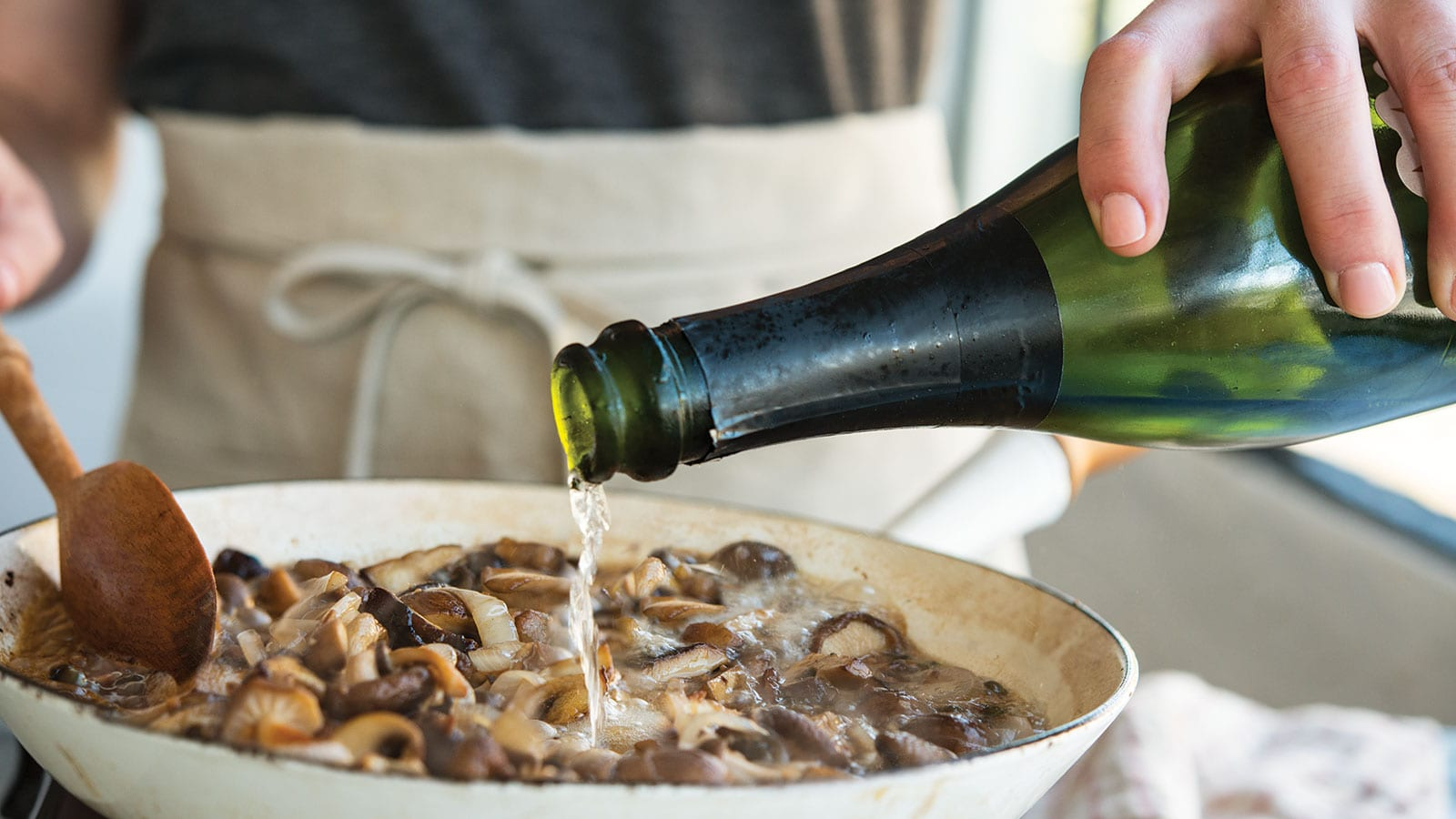 champagne pouring into skillet
