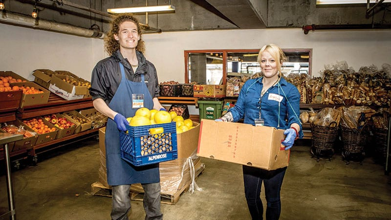 Happy workers of the Pike Place Market's food bank. Photo by Rosemary Dai Ross.