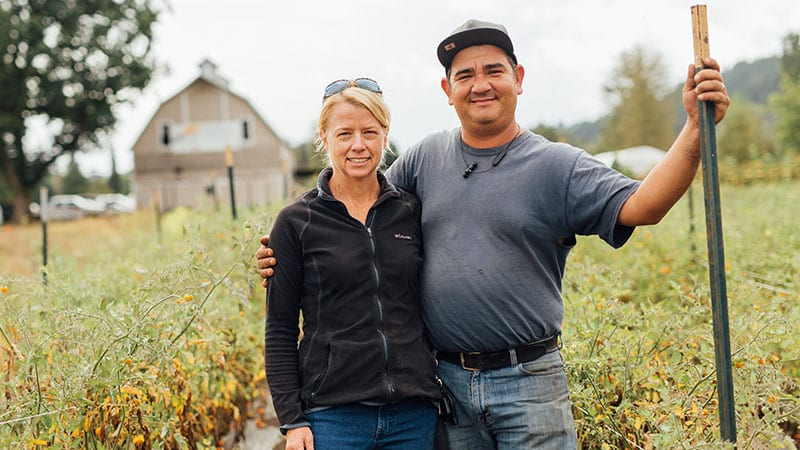 Owners of Four Elements Farm in front of their barn. Photo by Rylea Foehl courtesy of Pierce County Fresh.
